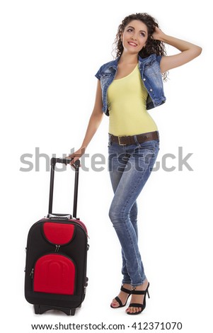 Travel and adventure concept. Beautiful Caucasian woman with a suitcase. Isolated on white background.