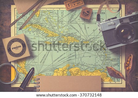 travel and photography inspired background/mock-up with various items on an antique map, vintage effect - stock photo