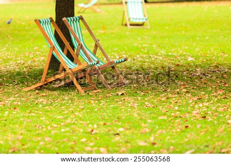 Travel and tourism. Empty chairs in St. James's Park London - stock photo