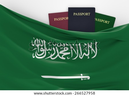 Travel and tourism in Saudi Arabia, with assorted passports - stock photo