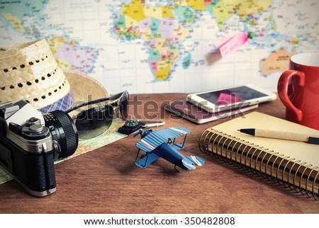Travel and vacation accessories on wooden background, Travel concept with copy space - stock photo