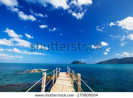travel and vacation concept - wooden bridge, sea, summer, vacation, happy time - stock photo