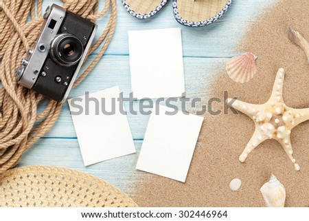 Travel and vacation photo frames and items on wooden table. Top view - stock photo