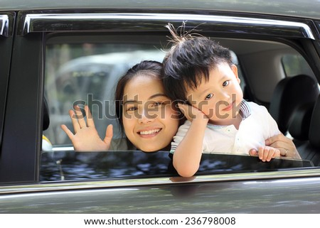 Travel Asian Family preparing with her son in the car