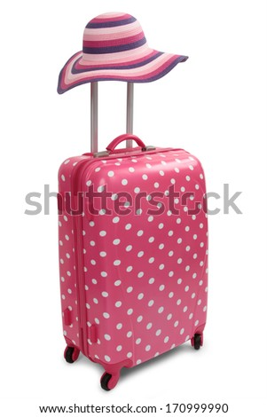 Travel bag and straw hat  - stock photo