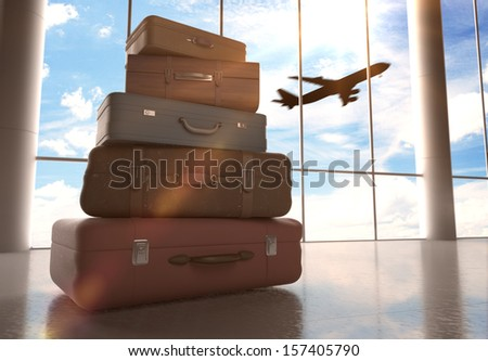 travel bags in airport and airliner in sky - stock photo