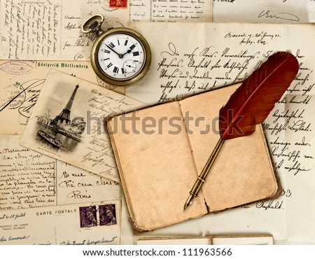 travel book diary, old letters, post cards and feather quill. nostalgic vintage background