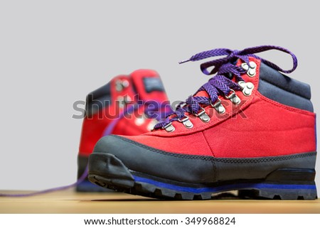 Travel boots over grey background