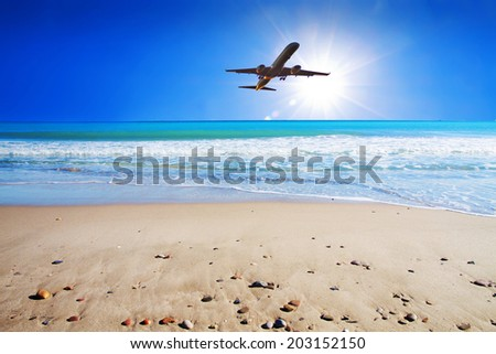travel by plane to the beach in summer - stock photo