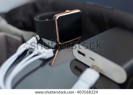 Travel charger and smart wrist watch and cable management for charge. This portable devices will let you stay connected to the network and work or have fun anywhere you want.