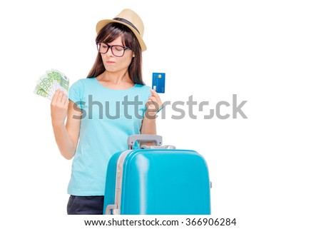 Travel concept. Cash or card? Studio portrait of pretty young woman holding money and plastic card. Isolated on white. - stock photo
