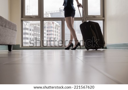 Travel concept - Close up of young woman arriving in a new city - stock photo