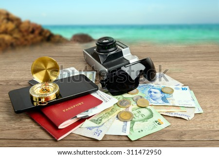 Travel concept, collage of  journey items and sea view - stock photo
