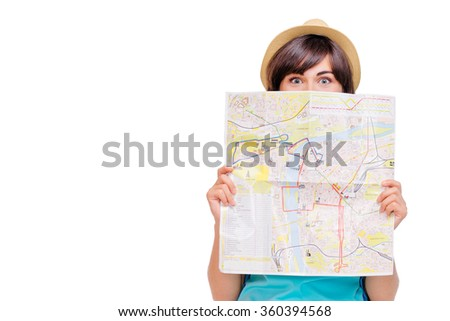 Travel concept. Dreaming about journey. Studio portrait of pretty young woman holding map. Isolated on white. - stock photo