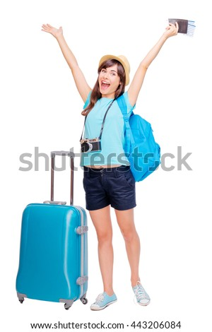 Travel concept. Full length studio portrait of pretty young woman holding passport with tickets. Isolated on white. - stock photo