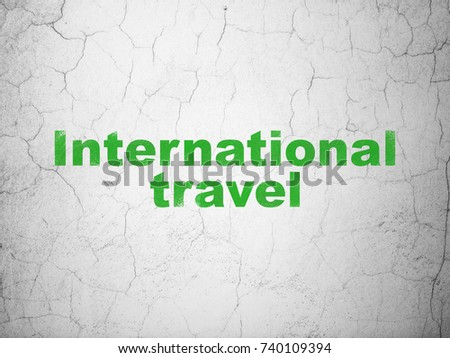 Travel concept: Green International Travel on textured concrete wall background