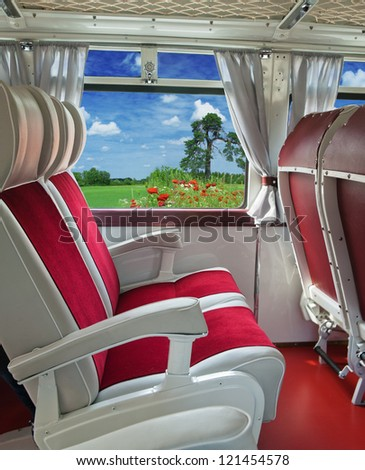 Travel concept. Interior of the old tourist bus - stock photo