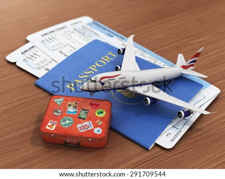 Travel concept. Passports, airline tickets, airplane and suitcase on the wood background. - stock photo