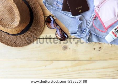 travel concept. set of women's accessories seen from above with free text space. summer holiday. over light