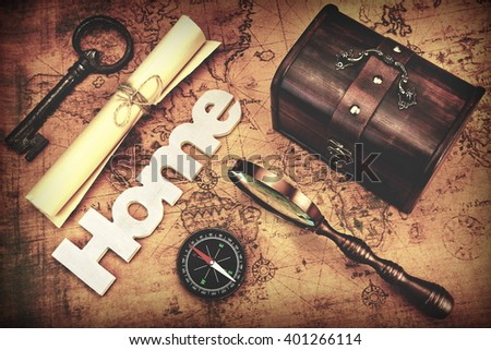 Travel Concept, Still Life Objects Key, Paper Roll, Home Sign, Magnifier, Compass And Key On Vintage Old Map Background With Photo Filter