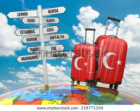 Travel concept. Suitcases and signpost what to visit in Turkey. - stock photo