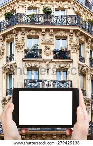 travel concept - tourist photograph corner of of typical house with balcony in Saint-germain-des-pres , Paris, France on tablet pc with cut out screen with blank place for advertising logo - stock photo