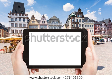 travel concept - tourist photograph old Market square in Trier, Germany on tablet pc with cut out screen with blank place for advertising logo - stock photo