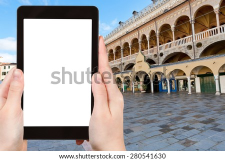travel concept - tourist photograph Palazzo della Ragione on Piazza delle Erbe in Padua, Italy on tablet pc with cut out screen with blank place for advertising logo
