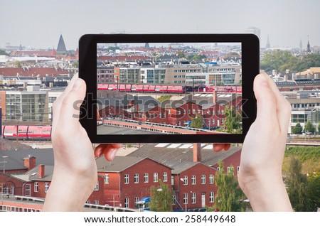 travel concept - tourist taking photo of Copenhagen skyline on mobile gadget, Denmark - stock photo