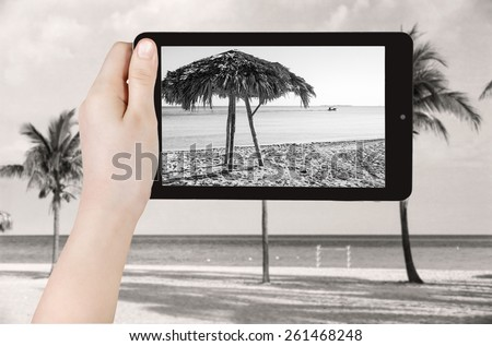 travel concept - tourist taking photo of sand beach in Varadero on mobile gadget, Cuba - stock photo