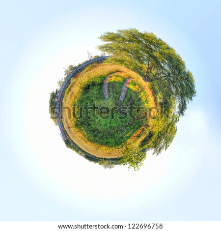 Travel concept. Train in field. Abstract mini planet. - stock photo