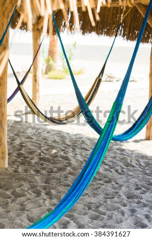 Travel concept with a hammock in a tropical beach