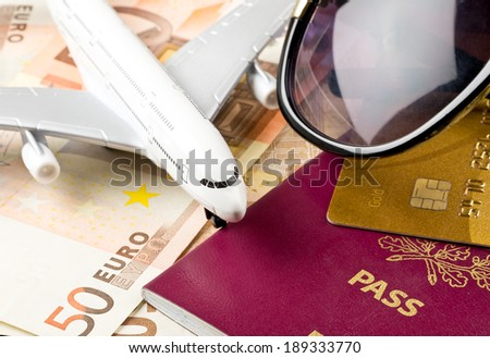 Travel concept with money documents and sunglasses - stock photo
