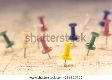 Travel concept with several pushpins on map,color filter effect - stock photo
