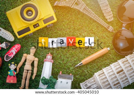 travel concept with souvenirs around the world on green grass view from top.jpg - stock photo