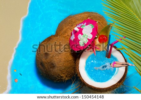 Travel Concept woman in Coconut cocktail swimming pool - stock photo
