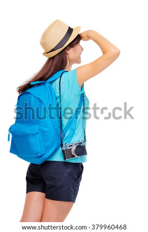 Travel concept. Young woman in hat with backpack looking away. Isolated on white. - stock photo