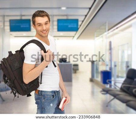 travel, education, tourism and people - smiling student with backpack and book at airport - stock photo