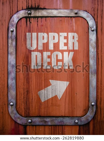 Travel Image Of A Grungy Upper Deck Sign On A Ship Or Ferry - stock photo