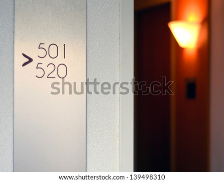Travel Image Of A Hotel Corridor With Light And Sign - stock photo