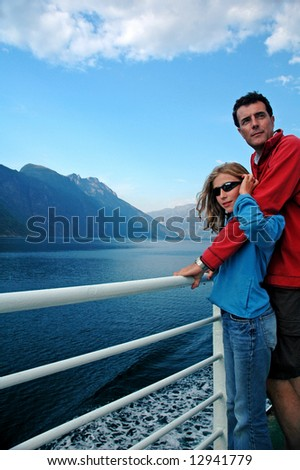 travel image of father and daughter on ferry - stock photo