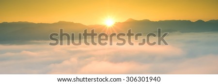 Travel in Mae Hong Son of Thailand, Camping outdoors, Sunset in the mist. Warm tone of color temperature. - stock photo