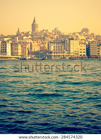 Travel in Turkey - panoramic view of Galata tower in Istanbul at sunset. Vertical photo of Istanbul cityscape and architectural landmark, concept for your postcard in retro style. - stock photo