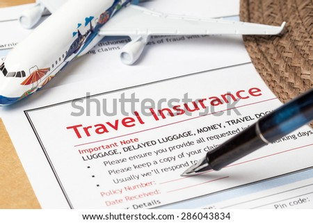 Travel Insurance Claim application form and hat with eyeglass and pen on brown envelope, business insurance and risk concept; document and plane is mock-up - stock photo