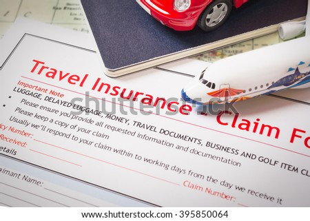 Travel Insurance Claim application form on table, business and risk concept; document,car and plane is mock-up