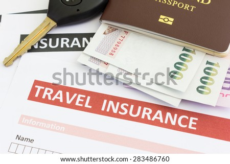 travel insurance form with car key and passport - stock photo