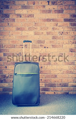 Travel luggage packed at home ready to go - stock photo