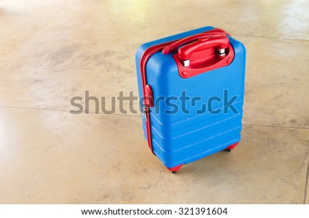 Travel luggage red and blue color - stock photo