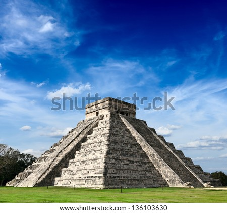 Travel Mexico background - Anicent Maya mayan pyramid El Castillo (Kukulkan) in Chichen-Itza, Mexico - stock photo