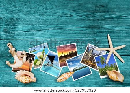 travel photos and seashells on azure wood background - stock photo